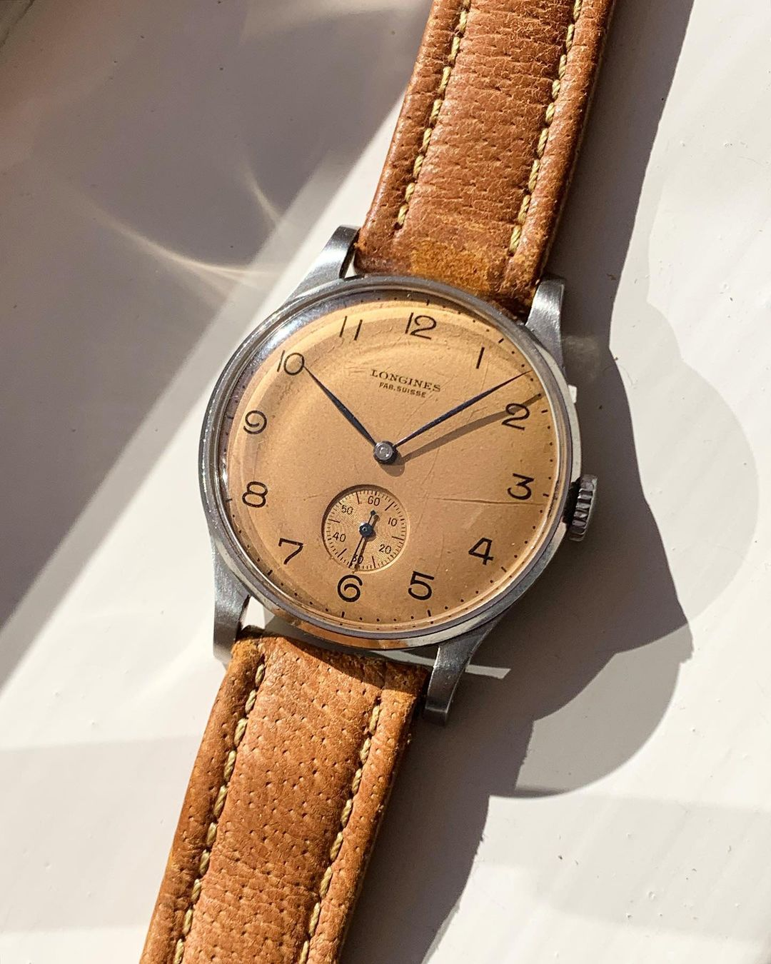 Vintage Longines time only watch with a small seconds and salmon dial for A Collected Man London