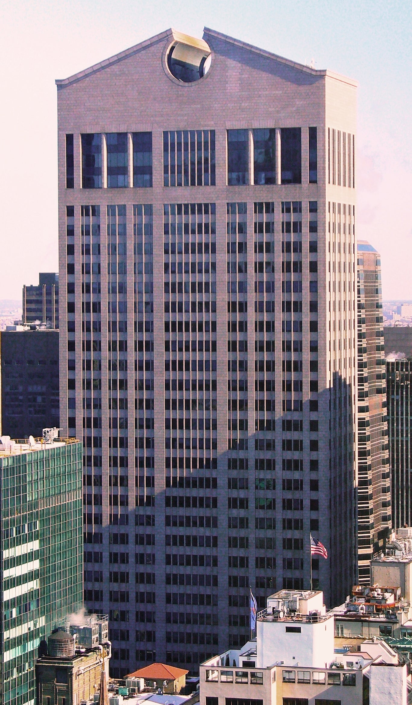The New York AT&T building completed in a postmodernist style with an added ornamental pediment atop for A Collected Man London