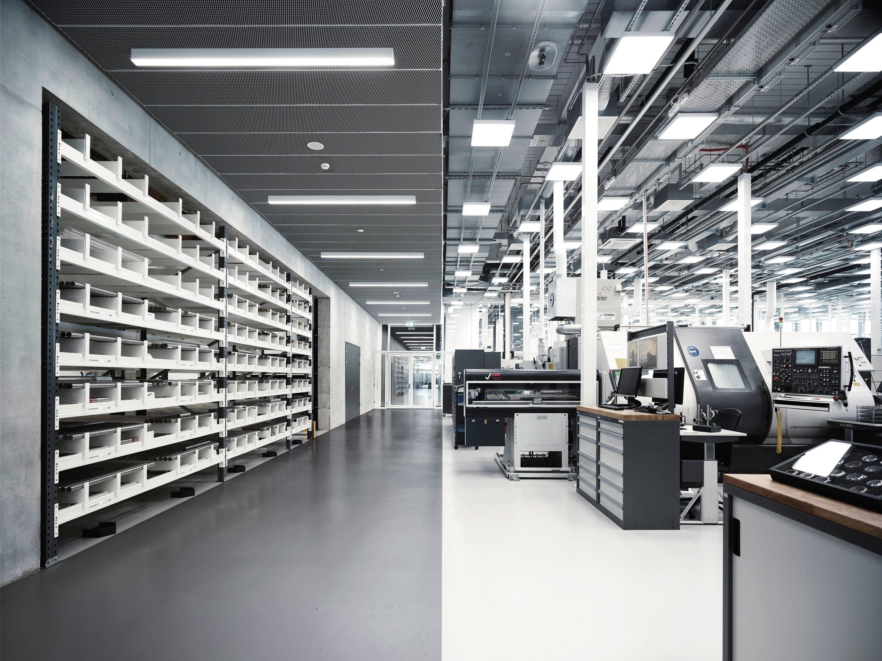 Inside the IWC manufacture with CNC machines and their metal storage area for A Collected Man London