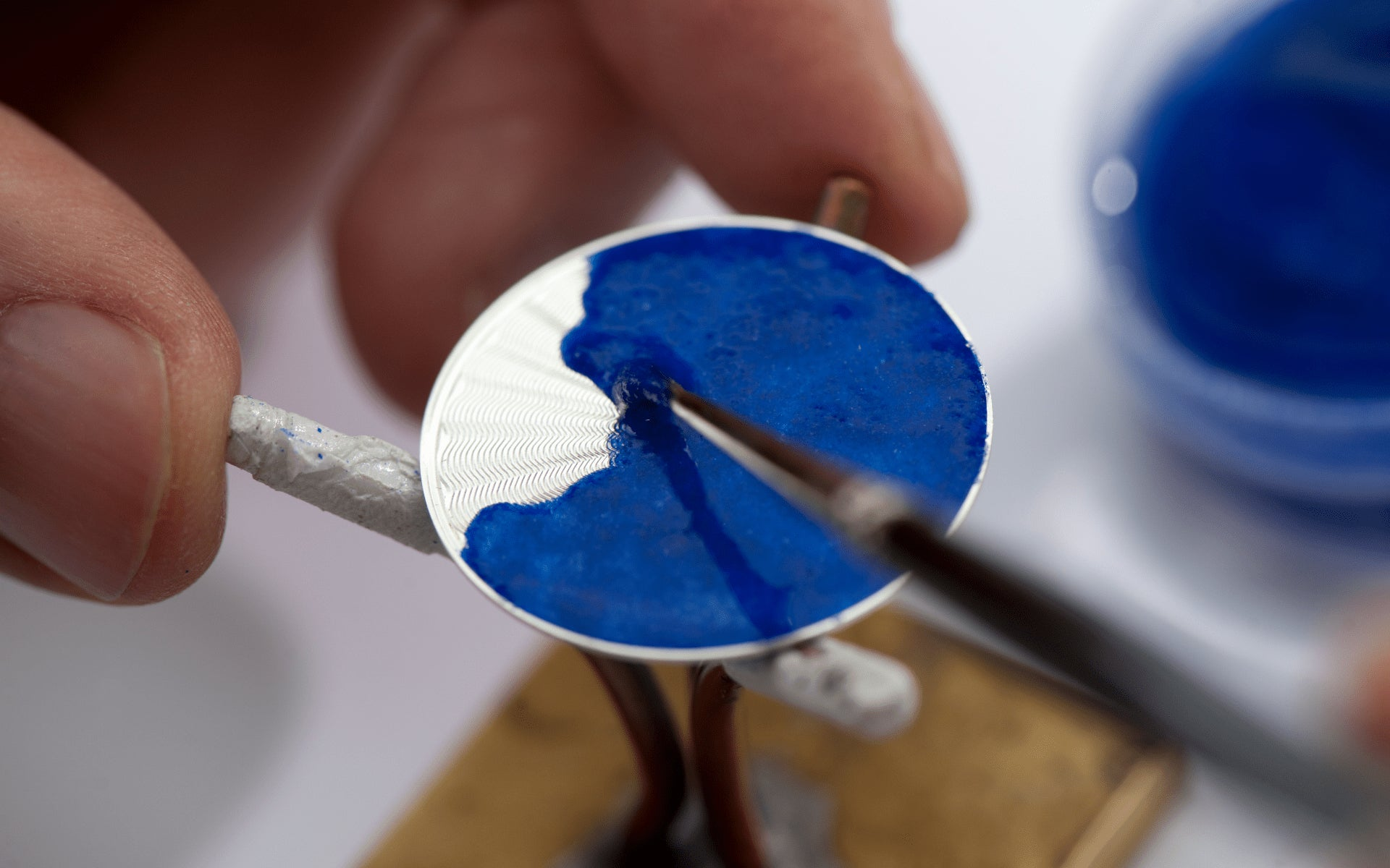 Blue enamel being painted of guillché dial in The Art of Enamel Dials for A Collected Man London
