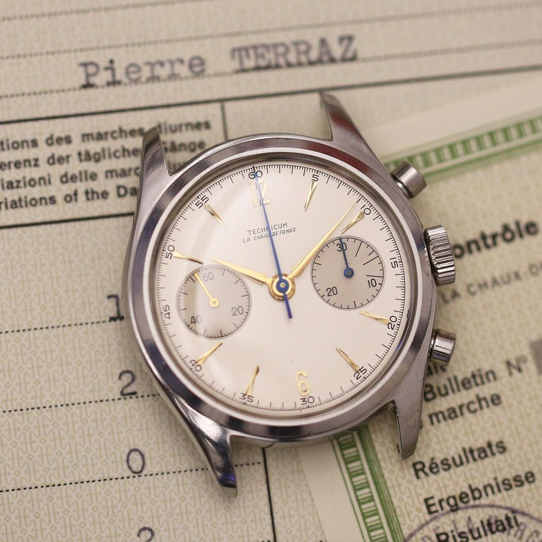 Vintage school watch on papers in The Importance of the School Watch for A Collected Man London