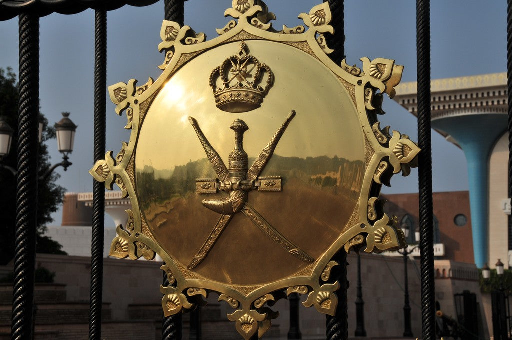 Golden Khanjar on the gate to the Royal Palace of Oman in Muscat for A Collected Man London