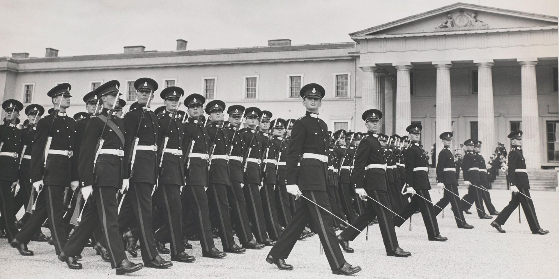 British officers parade outside of the Royal Military Academy Sandhurst in black and white for A Collected Man London
