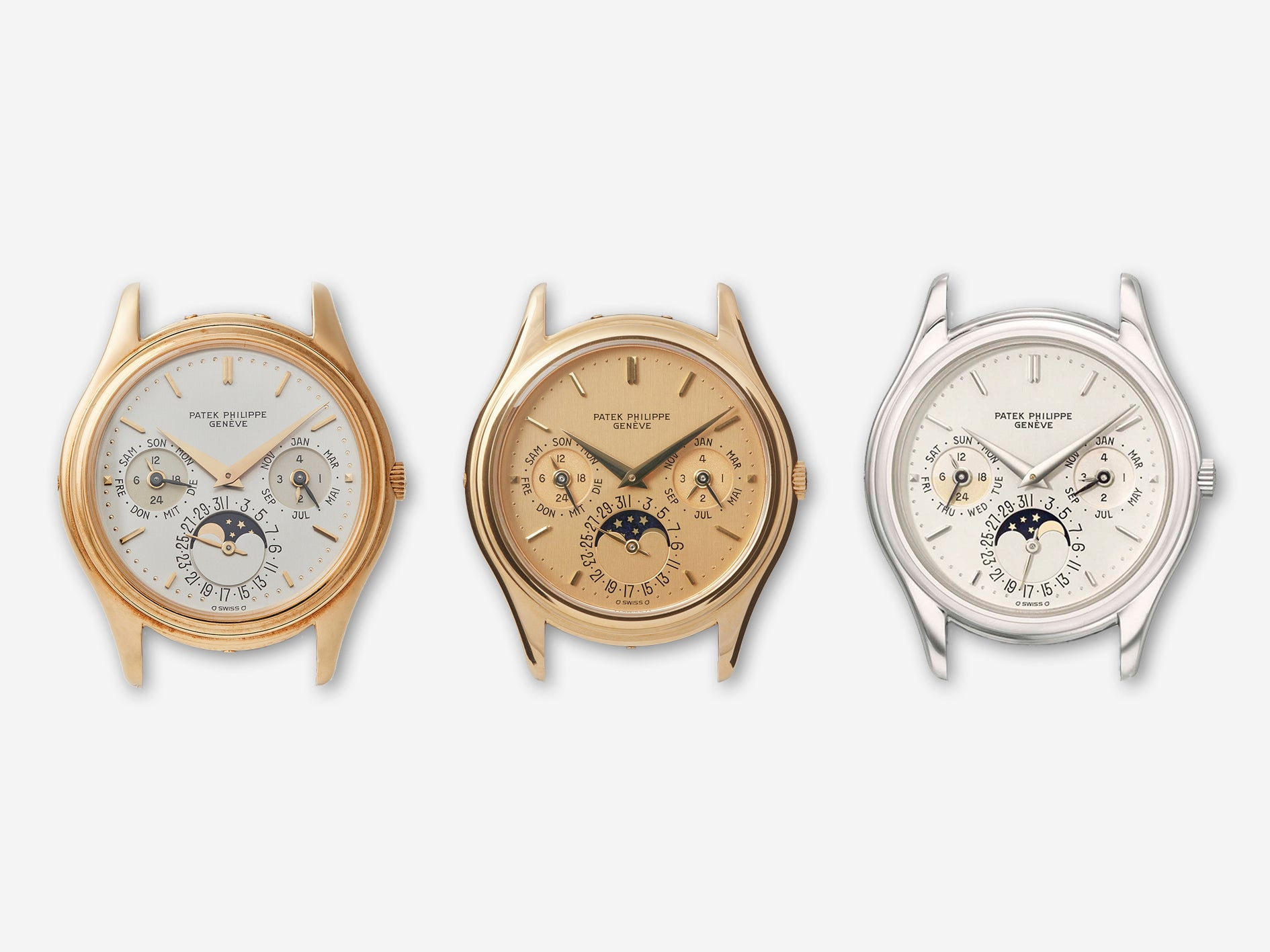 Three Patek Philippe 3940 first series with yellow gold and white gold cases with champagne and opaline dials