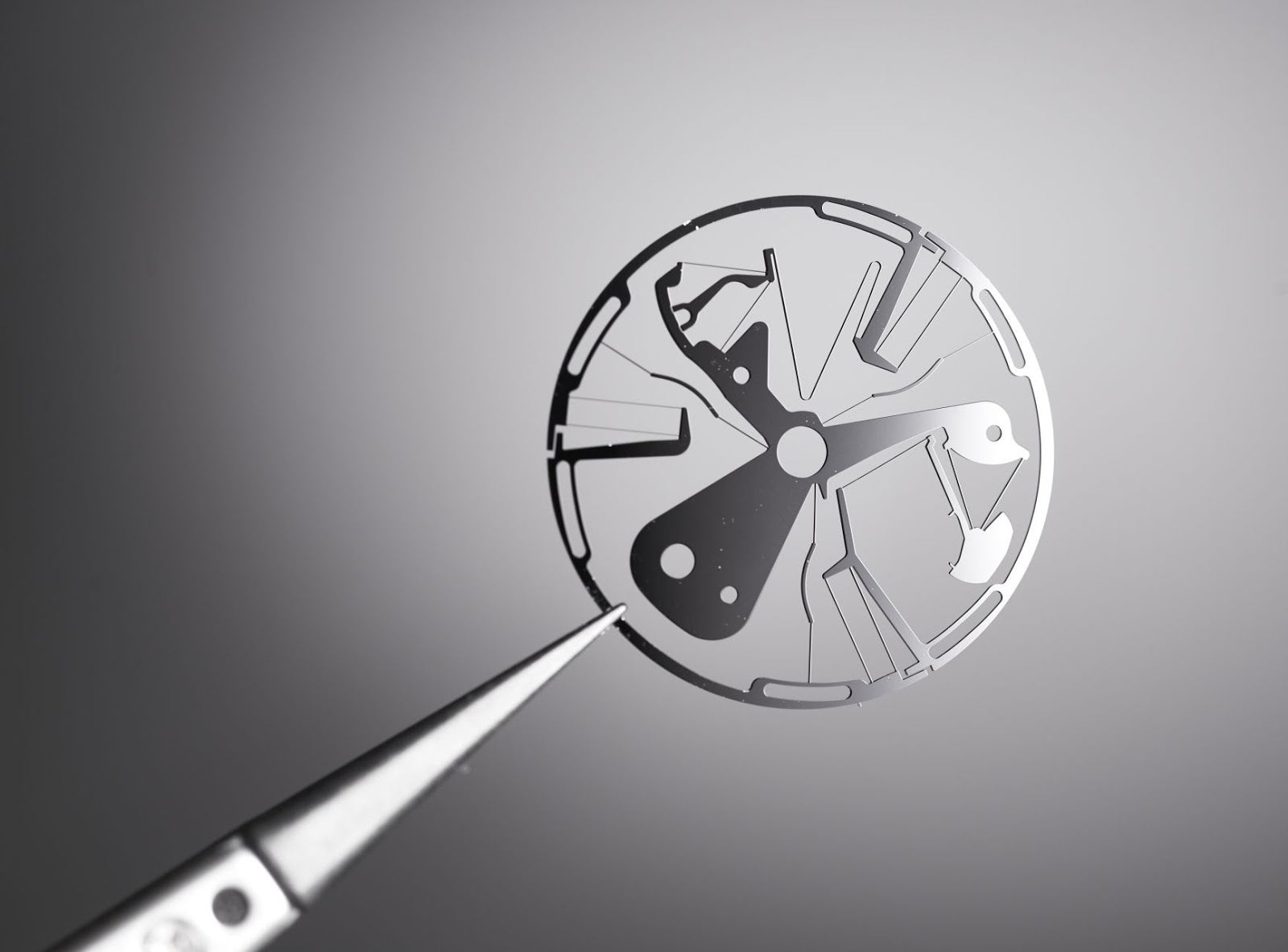 Silicone component in Zenith Defy inventor held by tweezers in Chasing Accuracy in Mechanical Wristwatches for A Collected Man London