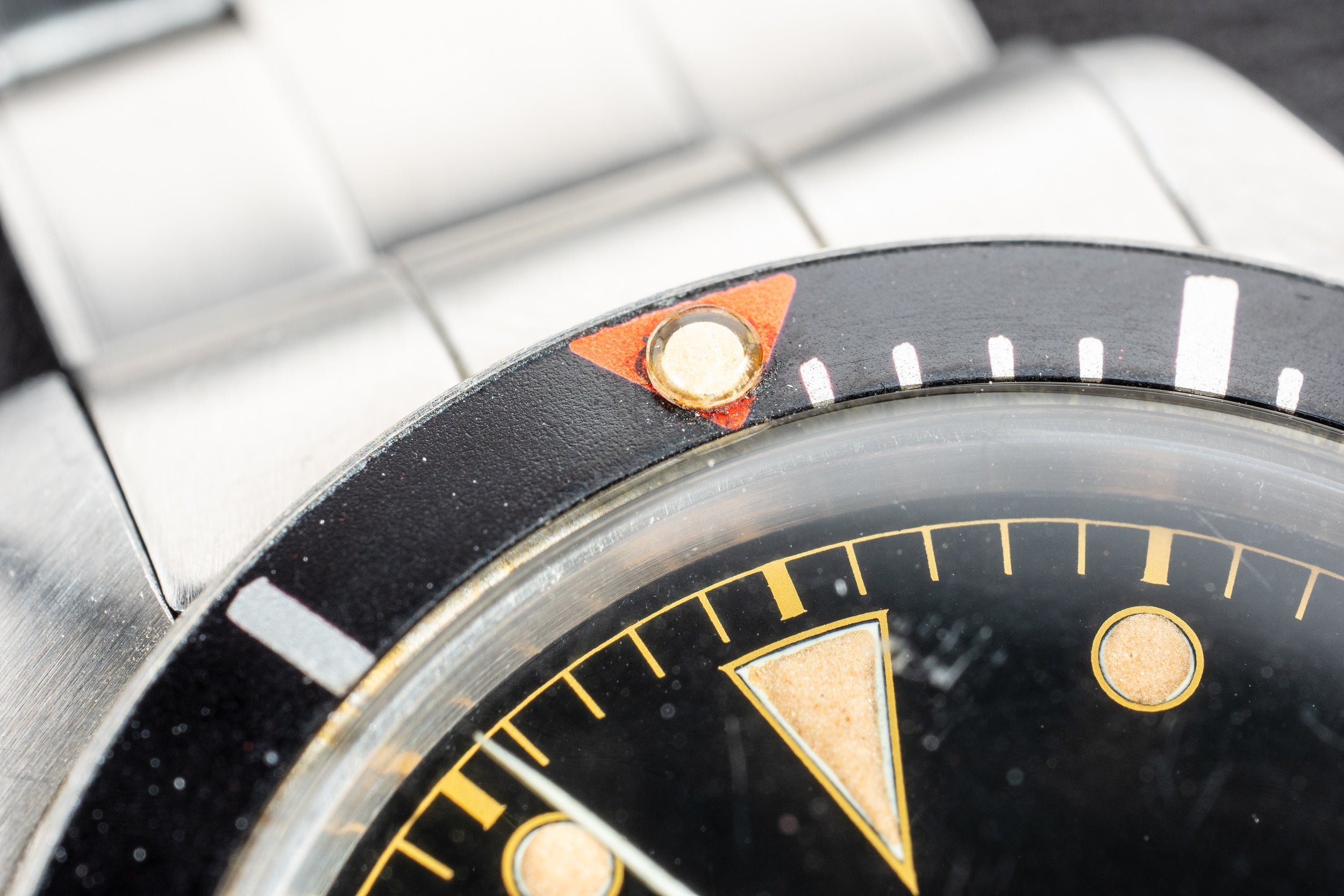 Macro on Rolex Submariner red triangle bezel in The Colourful World of Vintage Watches for A Collected Man London