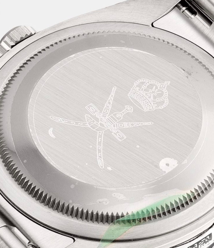 The caseback of a Rolex Dayton signed by Asprey that comes with Khanjar signed box and papers for A Collected Man London