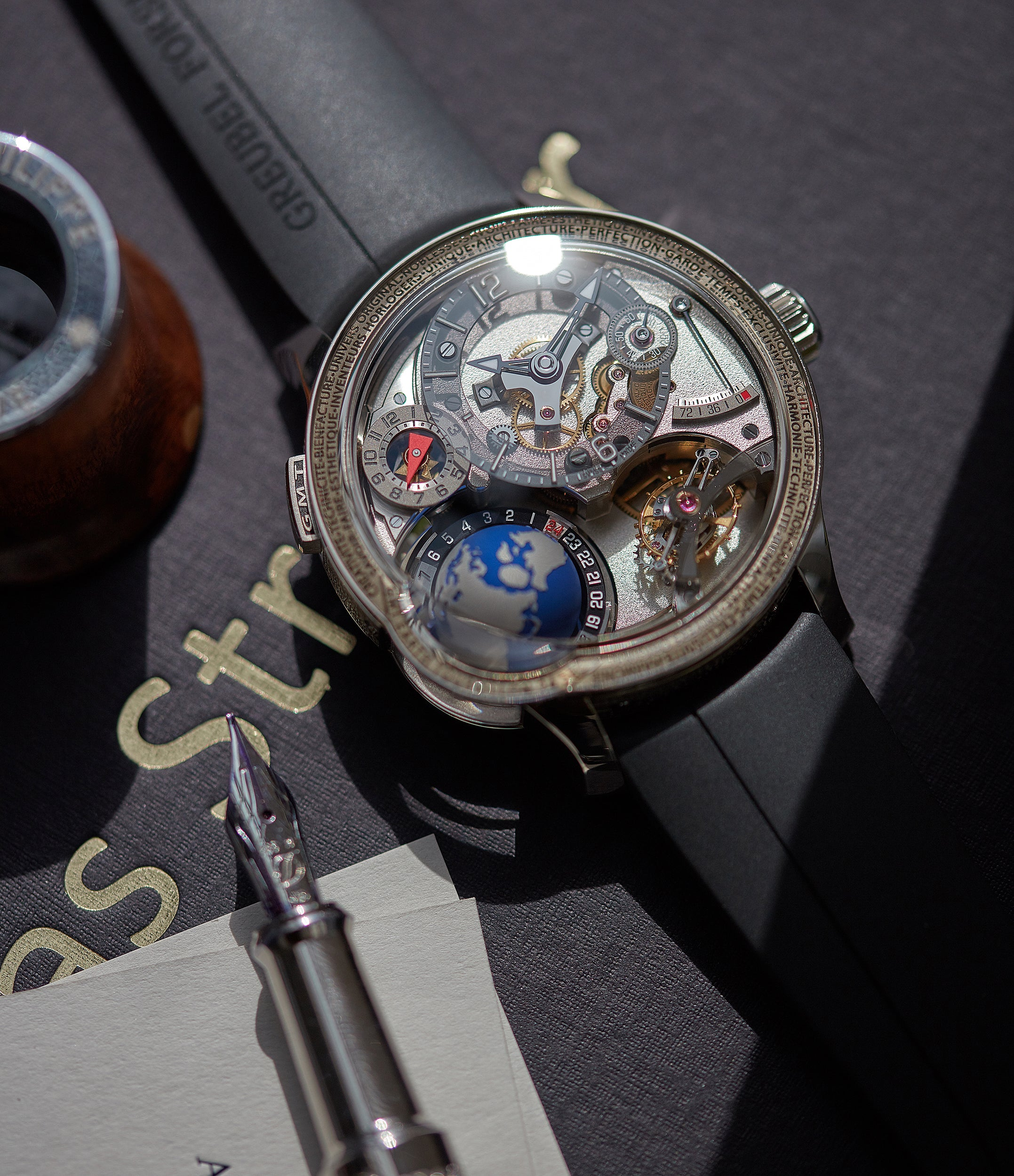 Spherical Earth globe day and night indication on rare GMT Earth Greubel Forsey