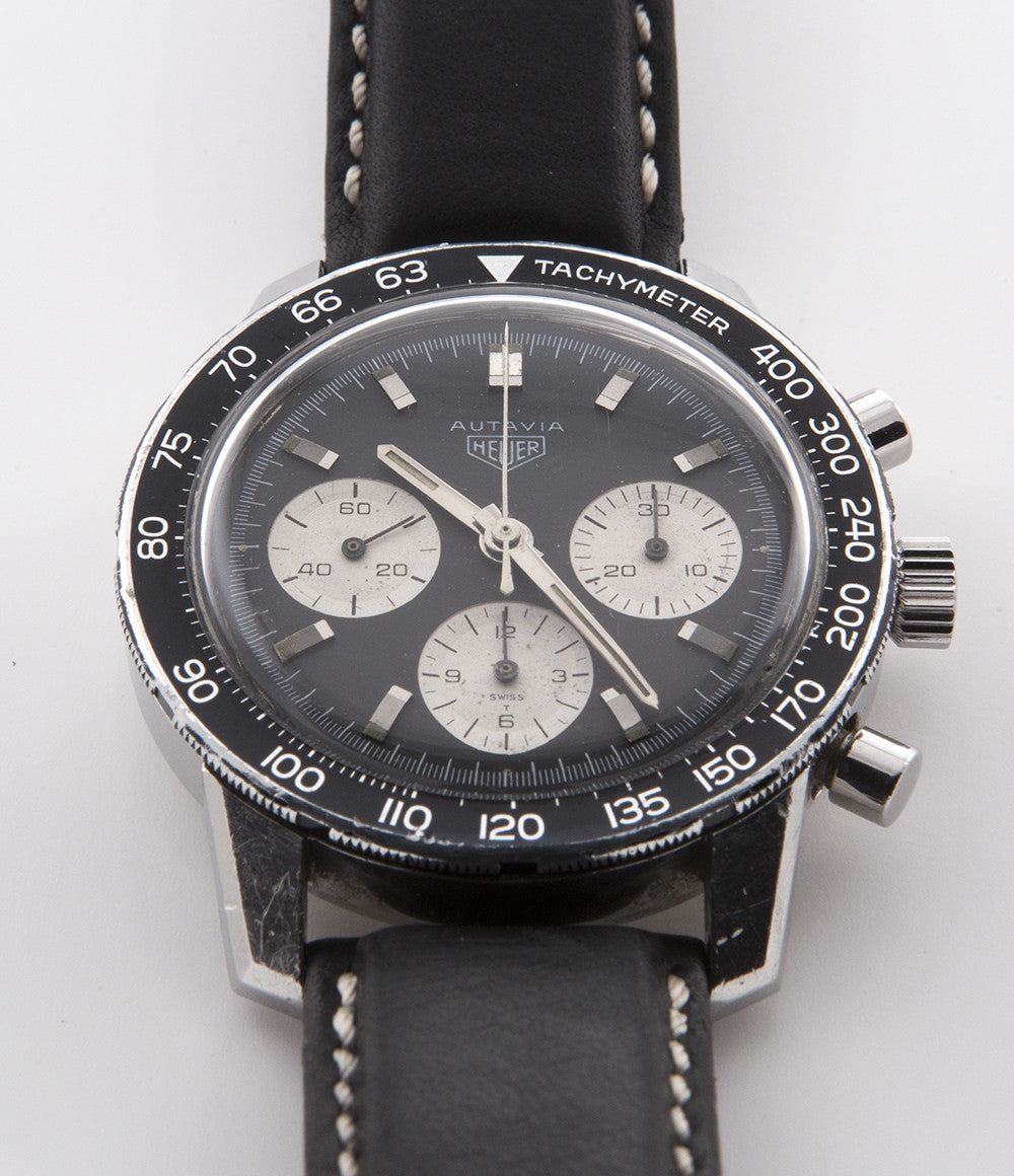 Heuer Autavia 2446C Valjoux 72 steel manual-winding vintage pre-owned watch with black and white dial and tachymeter scale
