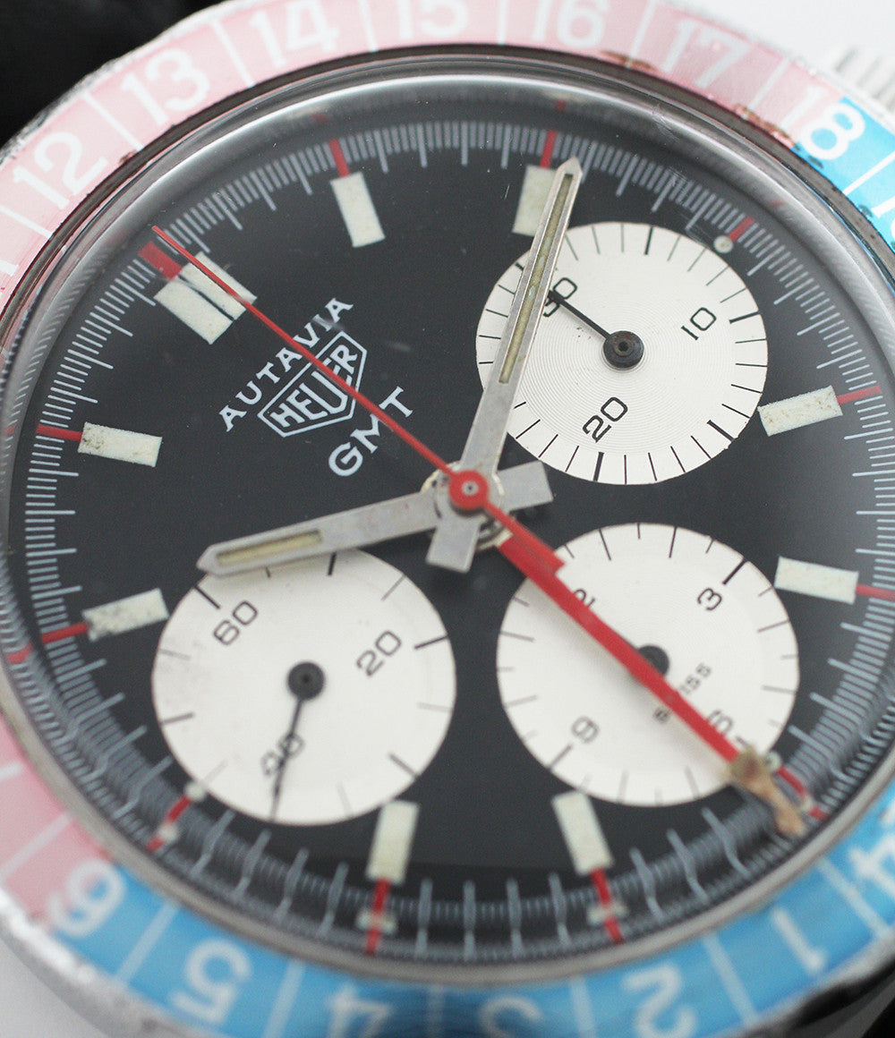 Heuer Autavia GMT 2446C steel manual-winding vintage pre-owned watch with black dial and black strap