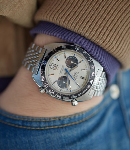 on the wrist vintage Heuer Autavia 1163T Siffert steel chronograph watch for sale online at A Collected Man London UK specialist of rare vintage watches