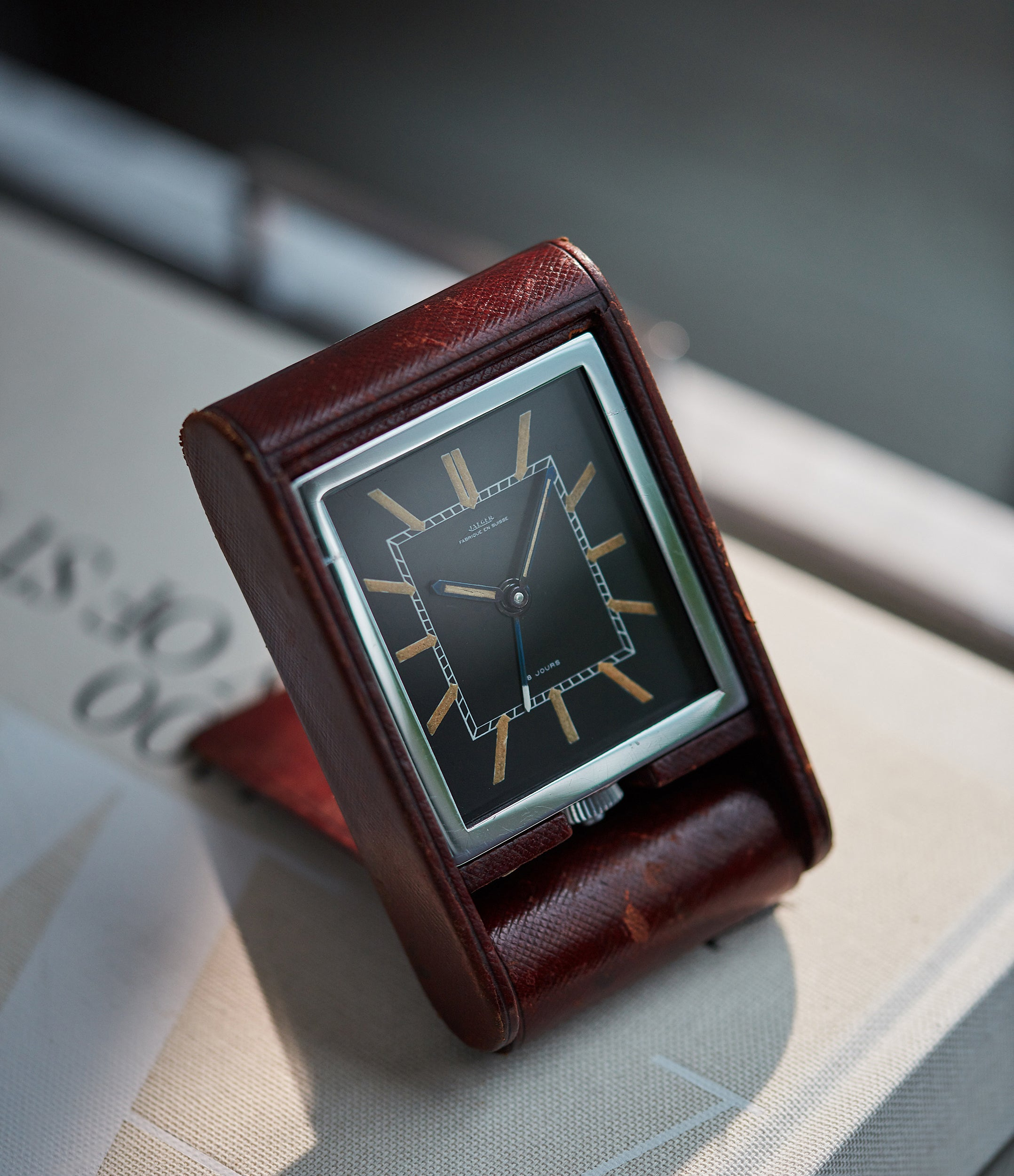 buy vintage Jaeger-LeCoultre travel alarm clock with black dial and brown case at A Collected Man London