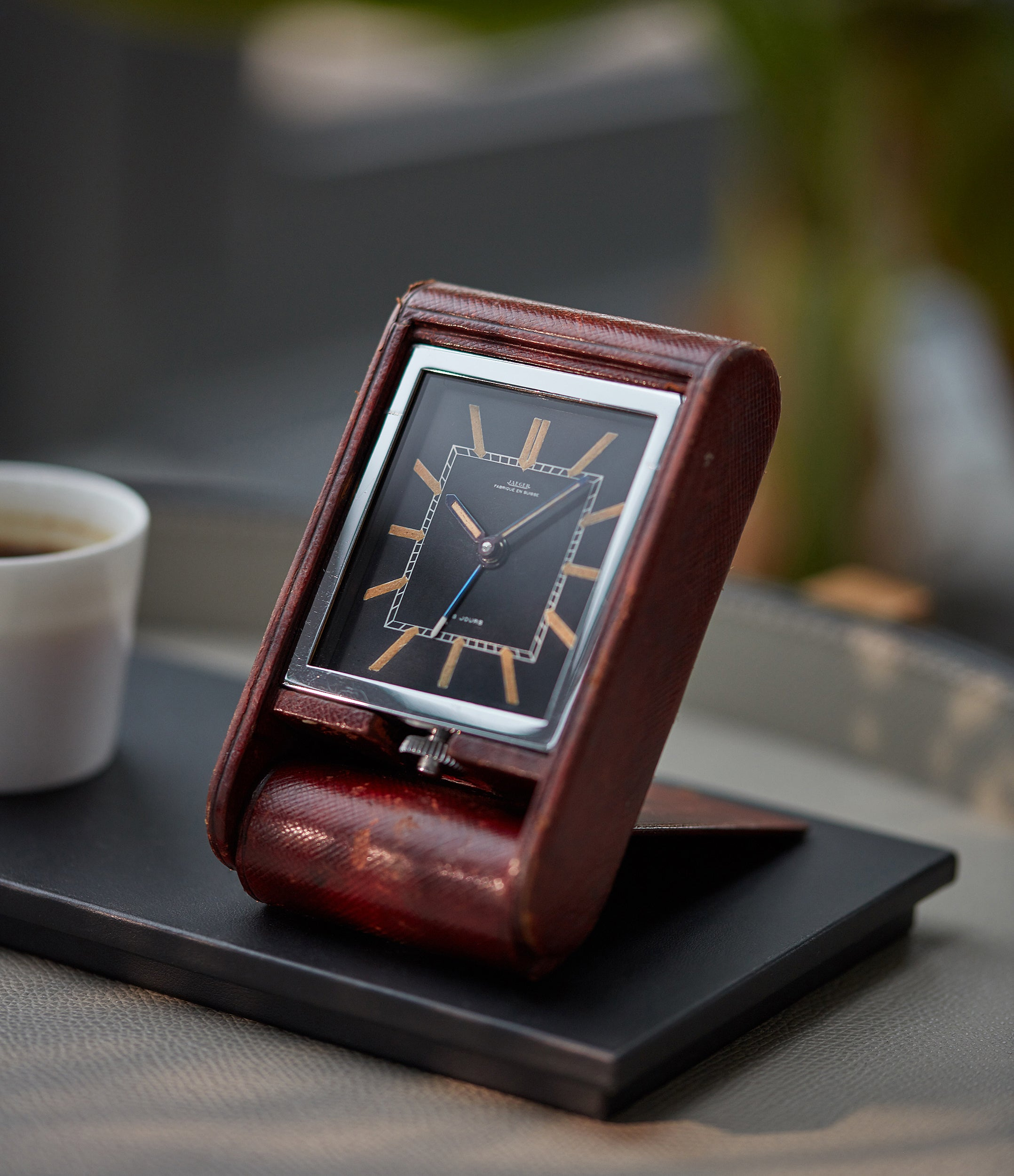 shop Jaeger-LeCoultre travel alarm clock with black dial and brown case at A Collected Man London