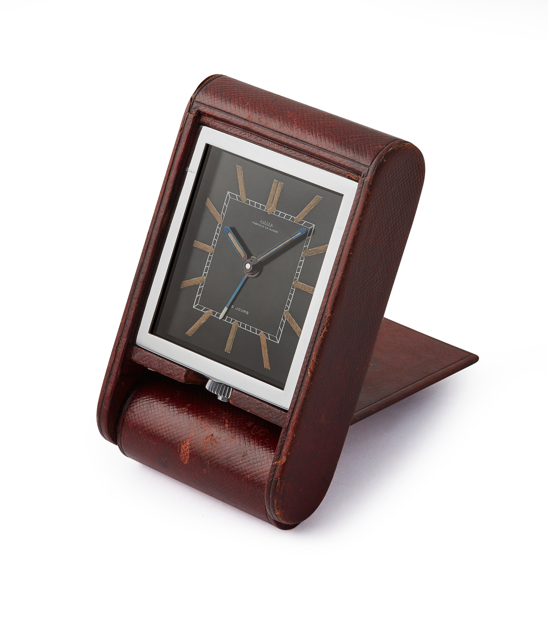 side-shot vintage Jaeger-LeCoultre travel alarm clock with black dial and brown case at A Collected Man London