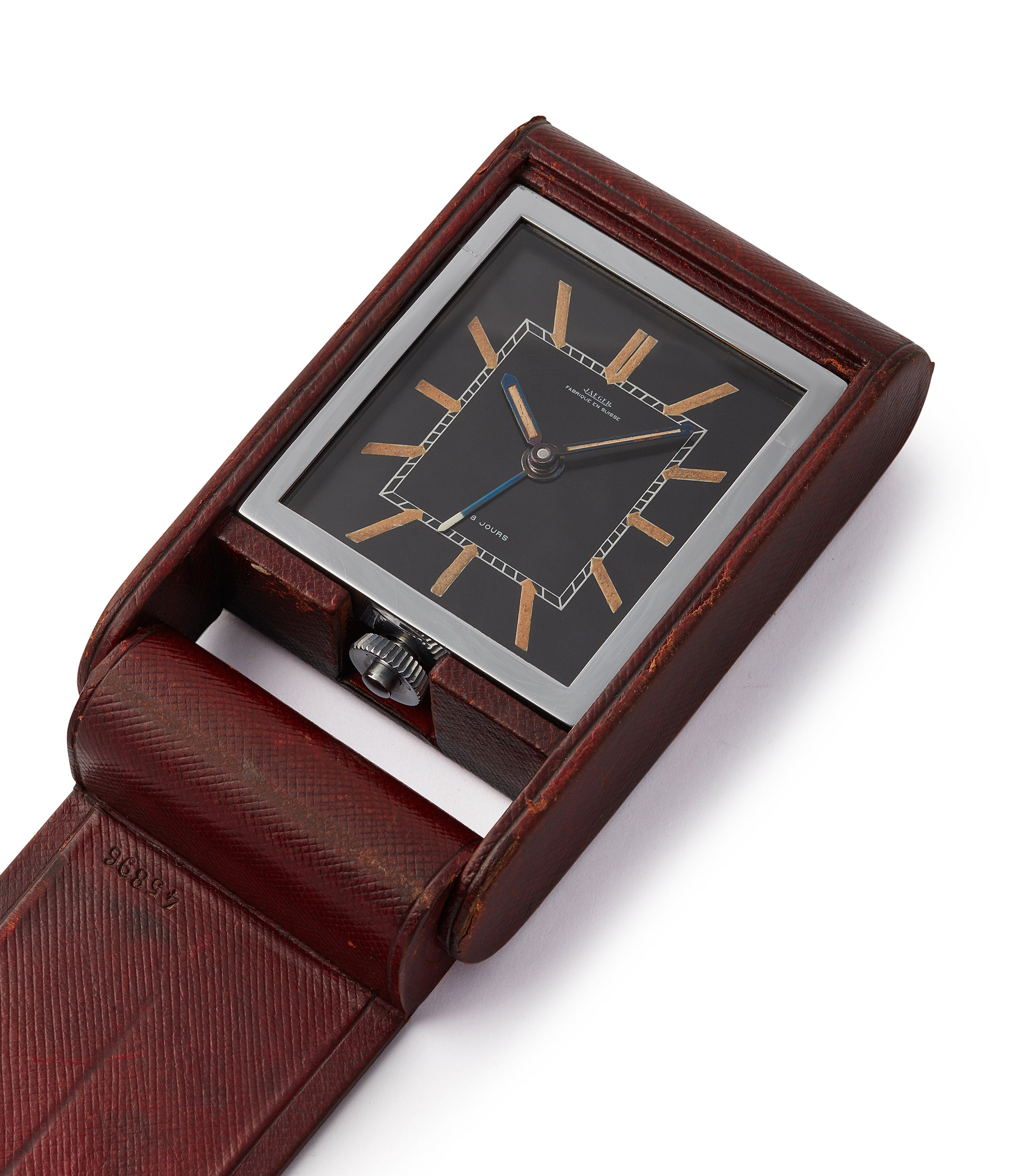 vintage Jaeger-LeCoultre travel alarm clock with black dial and brown case at A Collected Man London