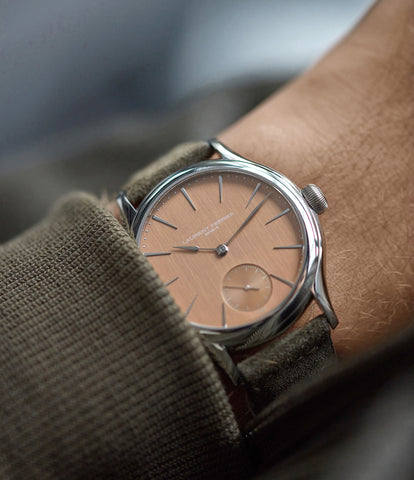 on the wrist Laurent Ferrier Galet Micro-rotor FBN 229.01 steel rare watch with pink salmon red gold dial for sale online at A Collected Man London approved re-seller of independent watchmakers