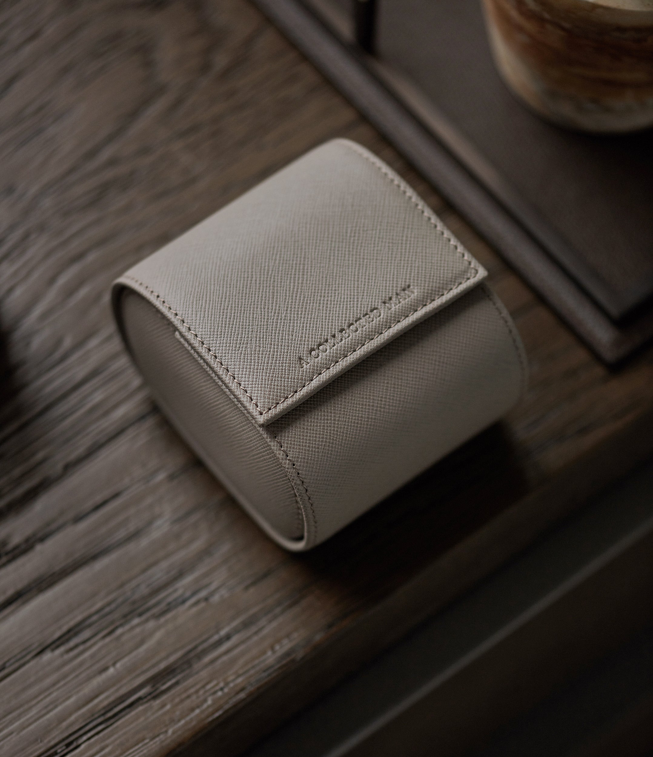 shop luxury light taupe grey Saffiano leather one-watch single watch roll holder Luxembourg Collection at A Collected Man London