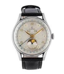 Omega Cosmic Triple Calendar Moon-phase 2471/1 stainless steel manual-winding Cal. 27 DLPC vintage authentic pre-owned dress luxury watch from 1946 with silver dial and black lizard strap with moonphase, month, date, weekday, hours, minutes, sub-seconds
