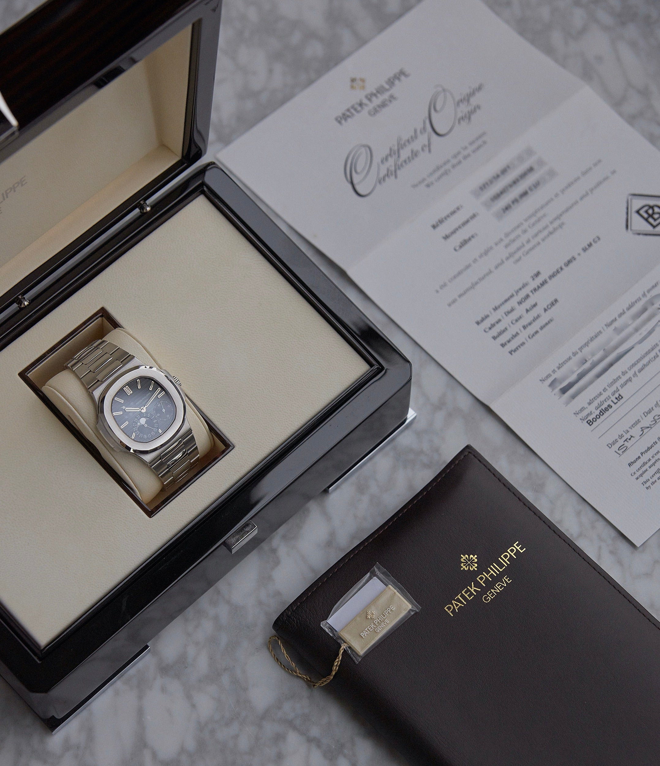 buy pre-owned Patek Philippe Nautilus 5712/1A-001 steel moon phase luxury sports watch for sale online A Collected Man London UK specialist rare watches