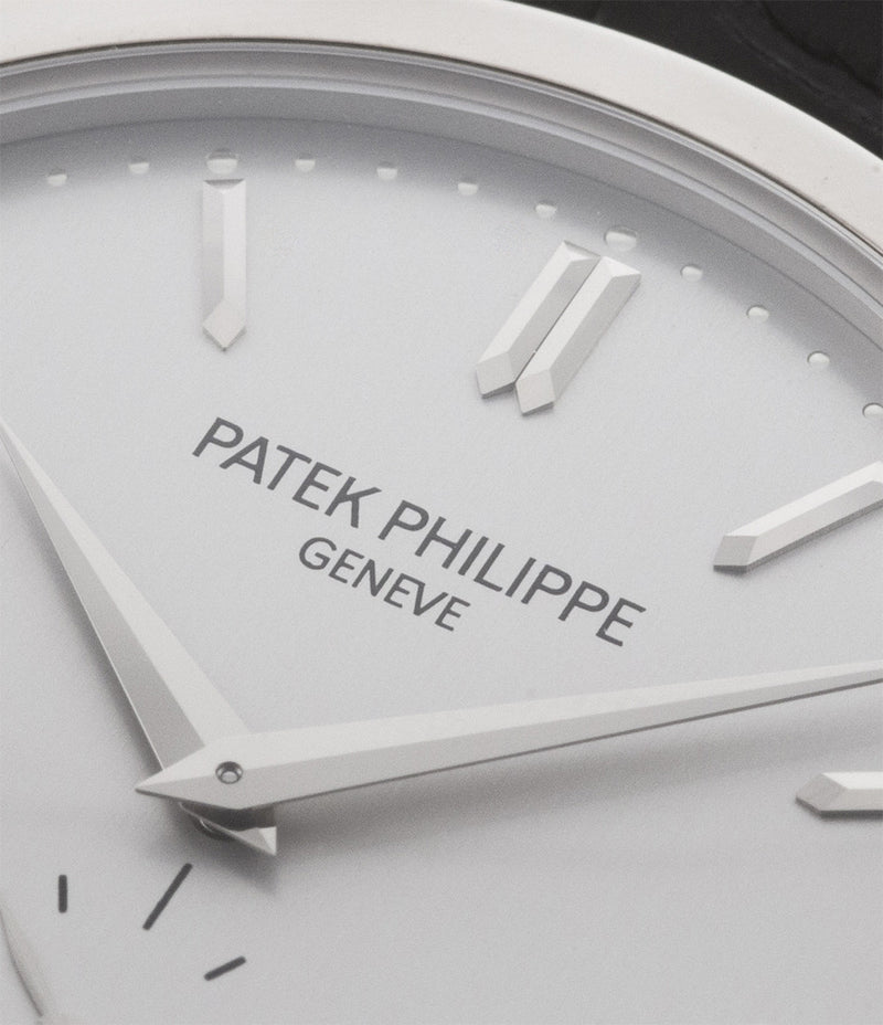 Patek Philippe Calatrava 5196G-001 18-carat white gold manual-winding pre-owned watch with silver dial and black strap