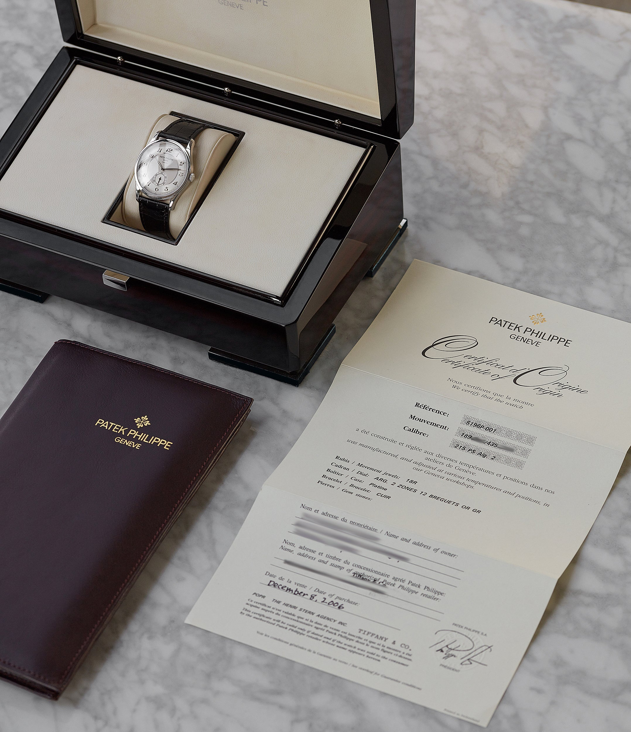 full set Patek Philippe Calatrava 5196P-001 Tiffany-signed manual-winding platinum pre-owned watch for sale online at A Collected Man London UK specialist of rare watches