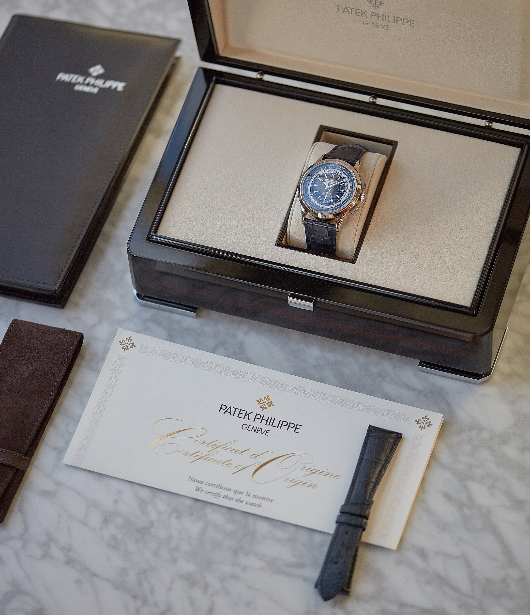 full set Patek Philippe Complications World Time Chronograph 5930G-001 white gold watch blue dial for sale online at A Collected Man London