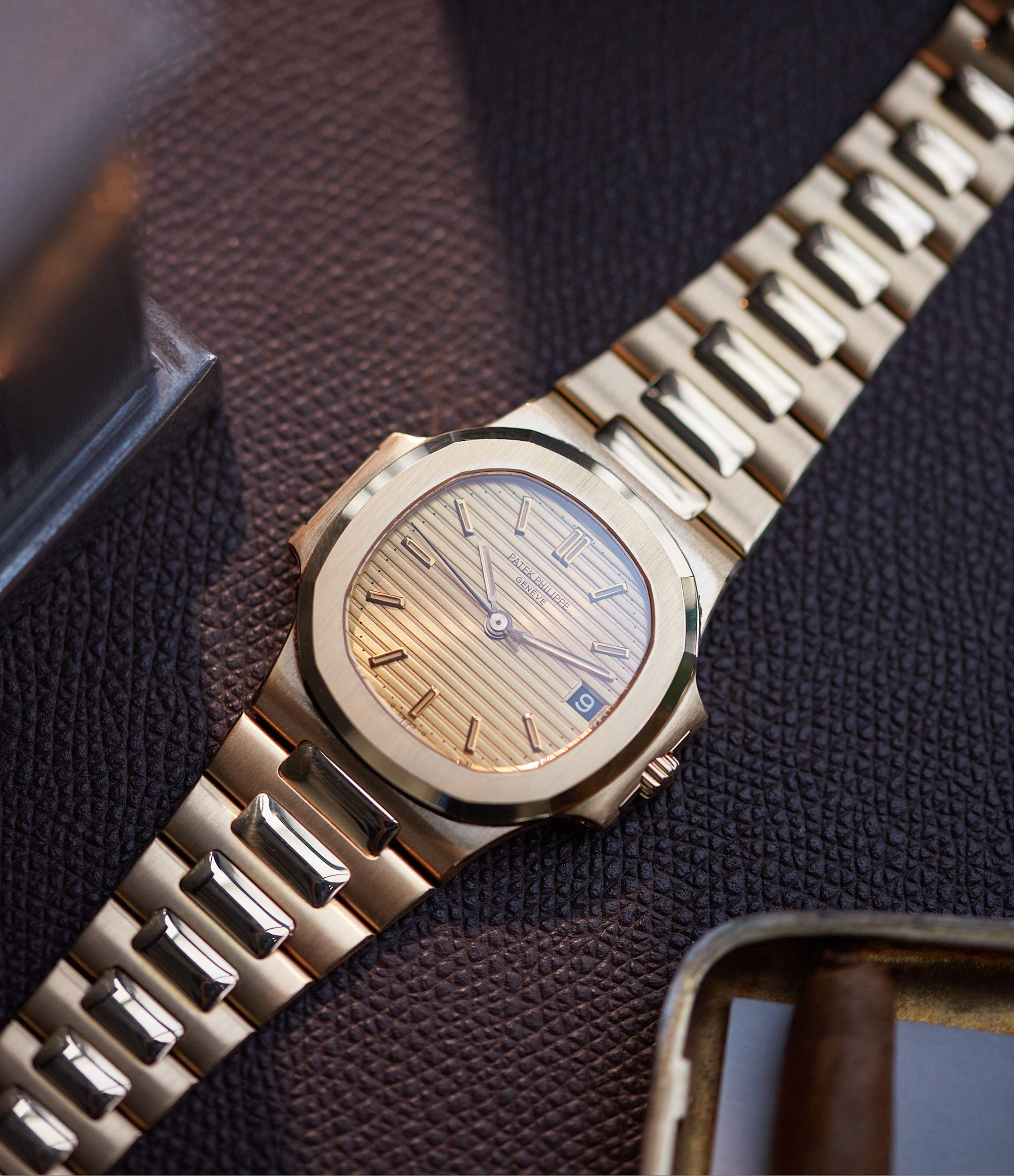 for sale Patek Philippe Nautilus Ref. 3800-001J yellow gold dark date disc luxury sports watch for sale online A Collected Man London UK specialist rare watches