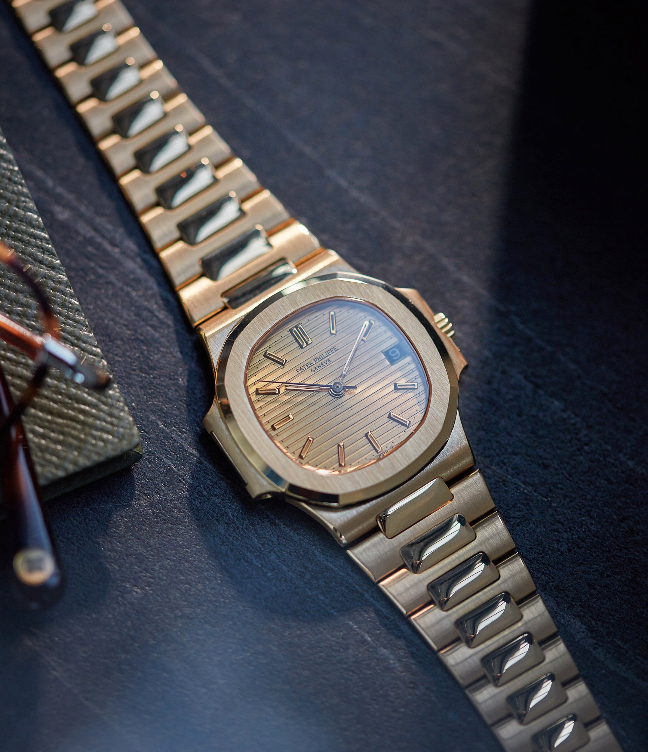 selling Patek Philippe Nautilus Ref. 3800-001J yellow gold dark date disc luxury sports watch for sale online A Collected Man London UK specialist rare watches