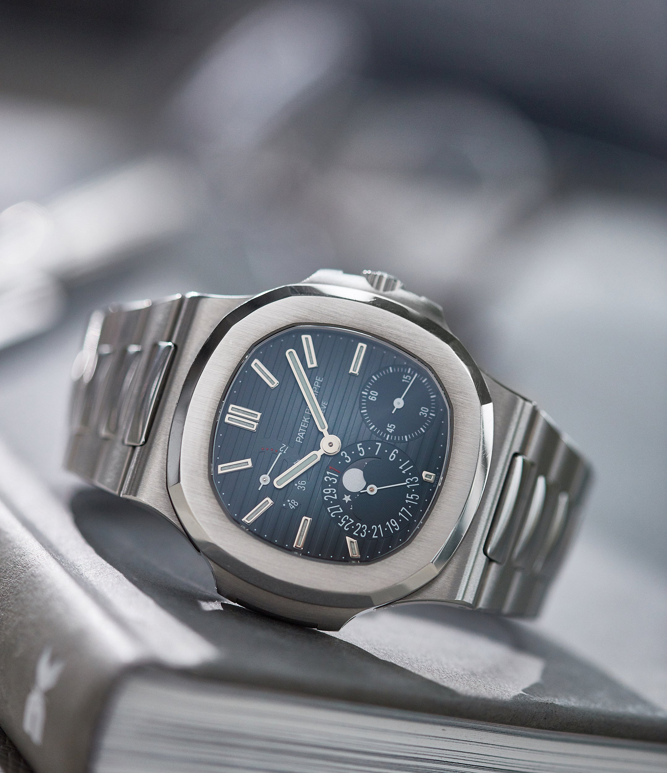 selling Patek Philippe Nautilus 5712/1A-001 steel moon phase luxury sports watch for sale online A Collected Man London UK specialist rare watches