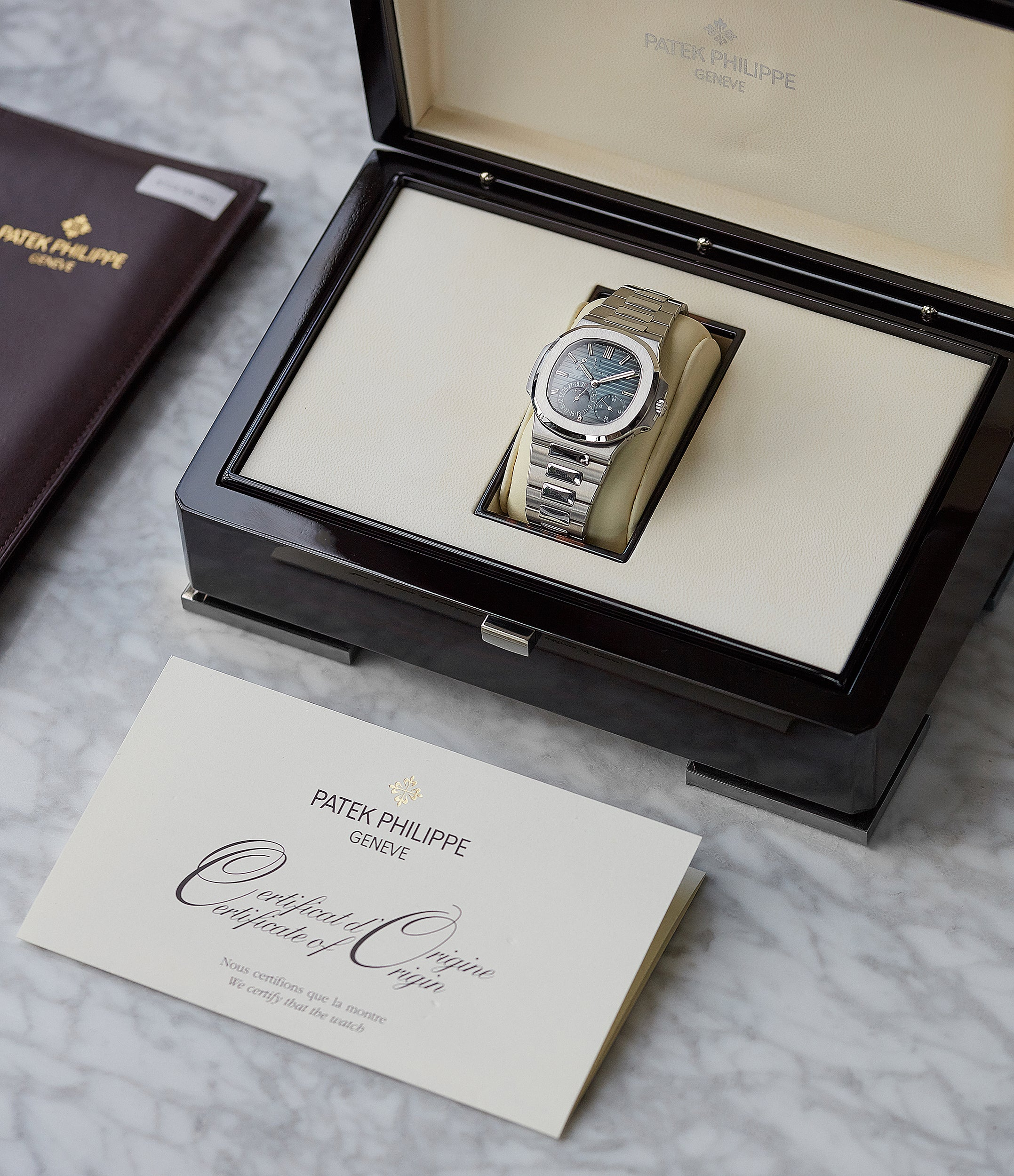 full set pre-owned Patek Philippe Nautilus Moon Phase 5712/1A-001 steel watch for sale online at A Collected Man London UK specialist of rare watches