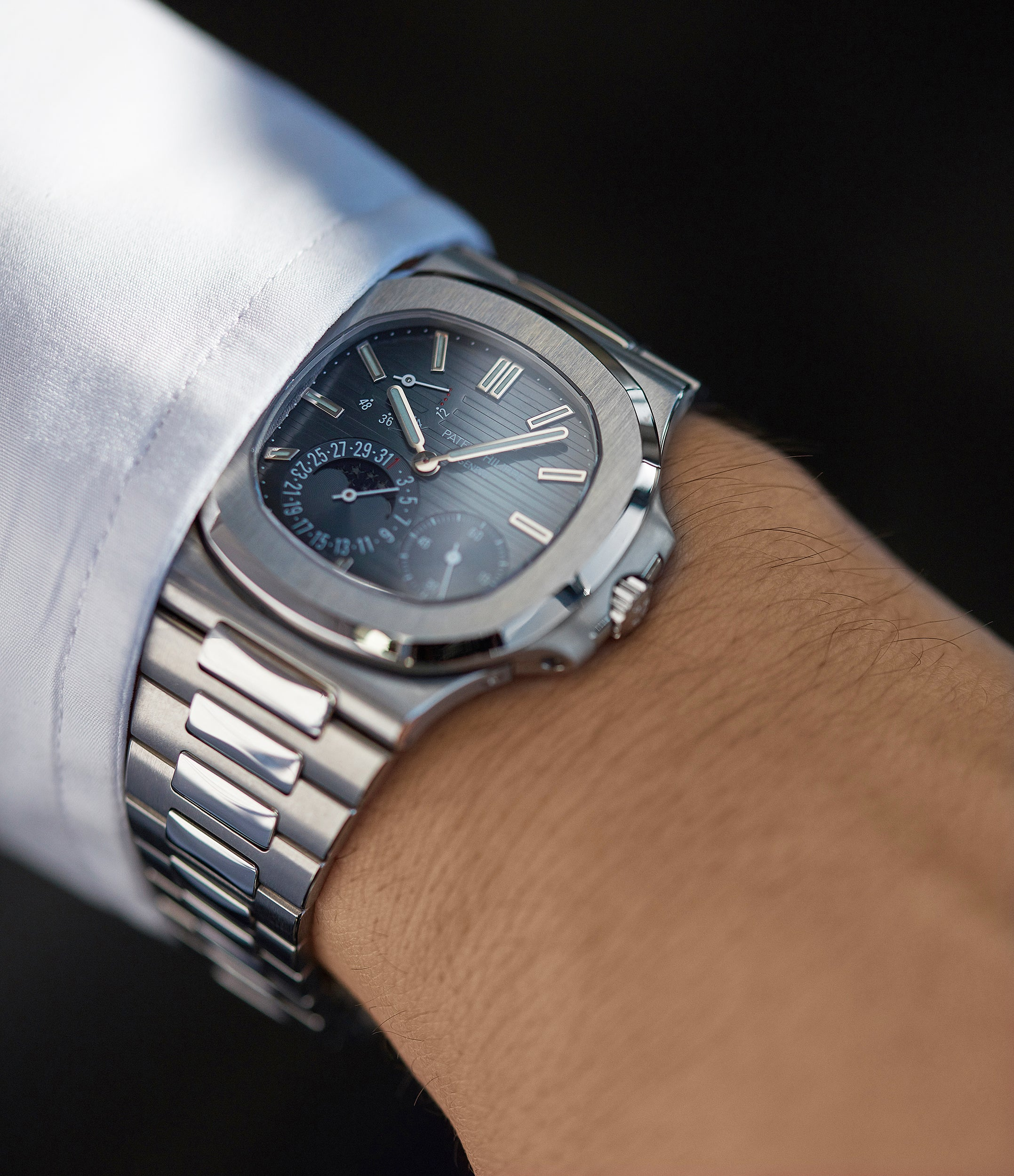 on the wrist Patek Philippe Nautilus Moon Phase 5712/1A-001 steel pre-owned watch for sale online at A Collected Man London UK specialist of rare watches