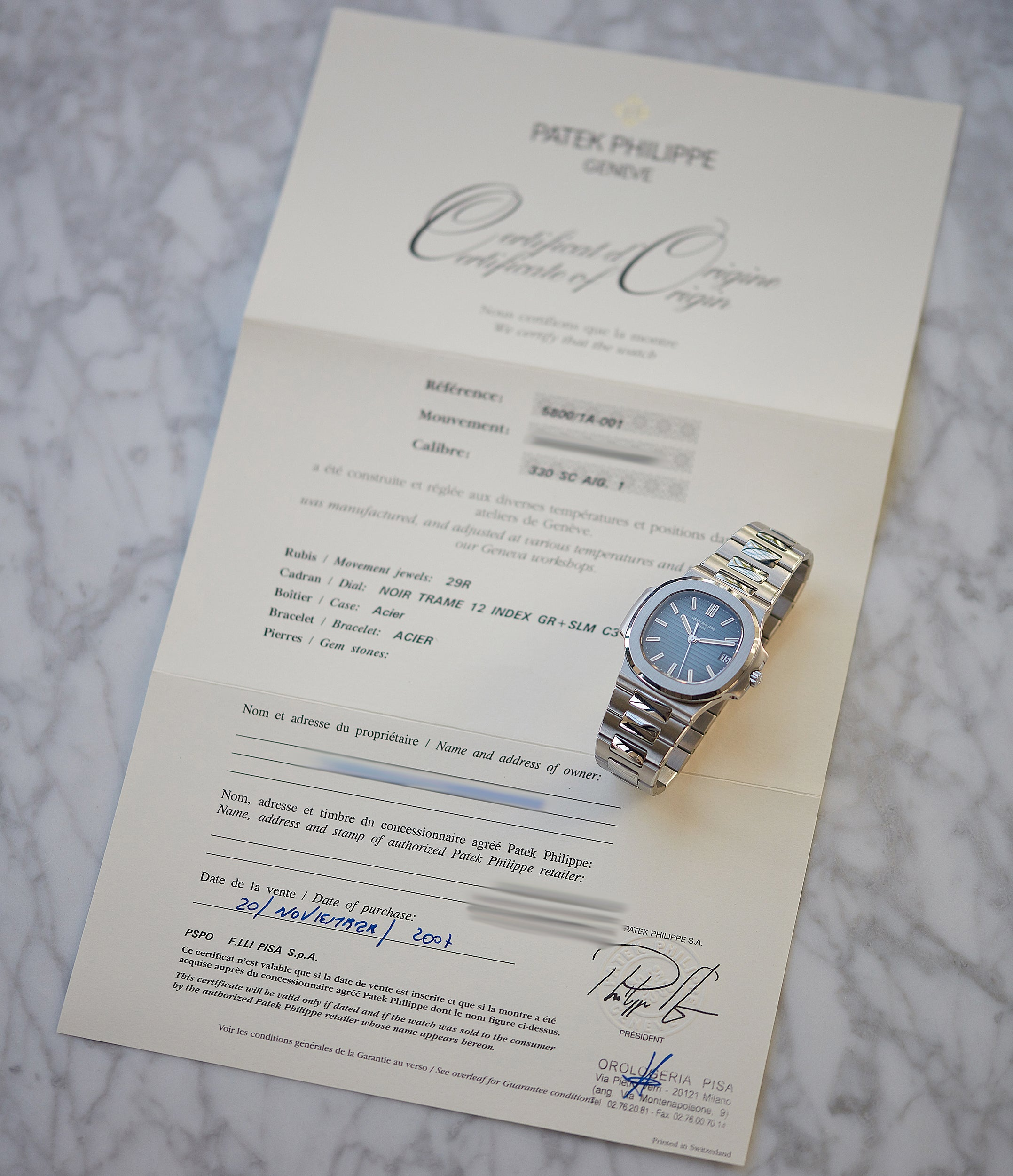 This Patek Philippe Nautilus 5800 comes with its original box, Certificate of Origin and product literature