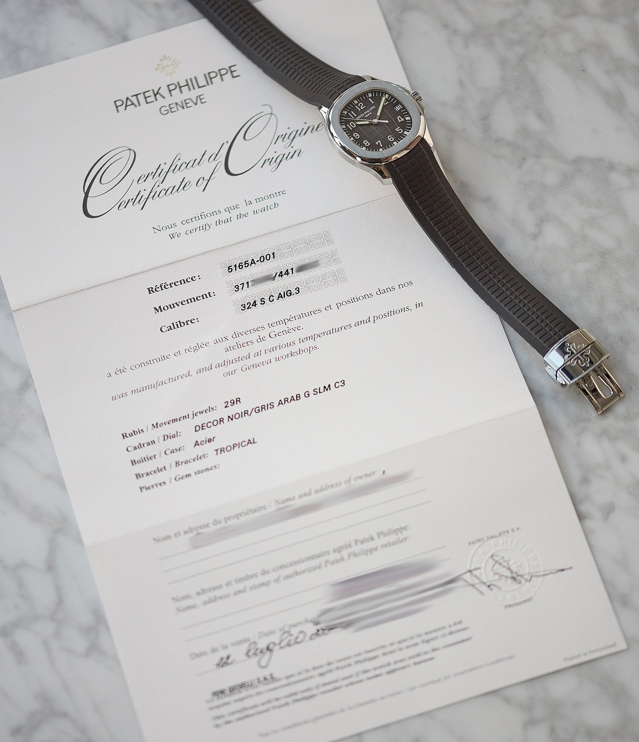 certificate of origin Patek Philippe Aquanaut 5165A-001 transitional steel sport watch for sale online at A Collected Man London UK specialist of rare watches