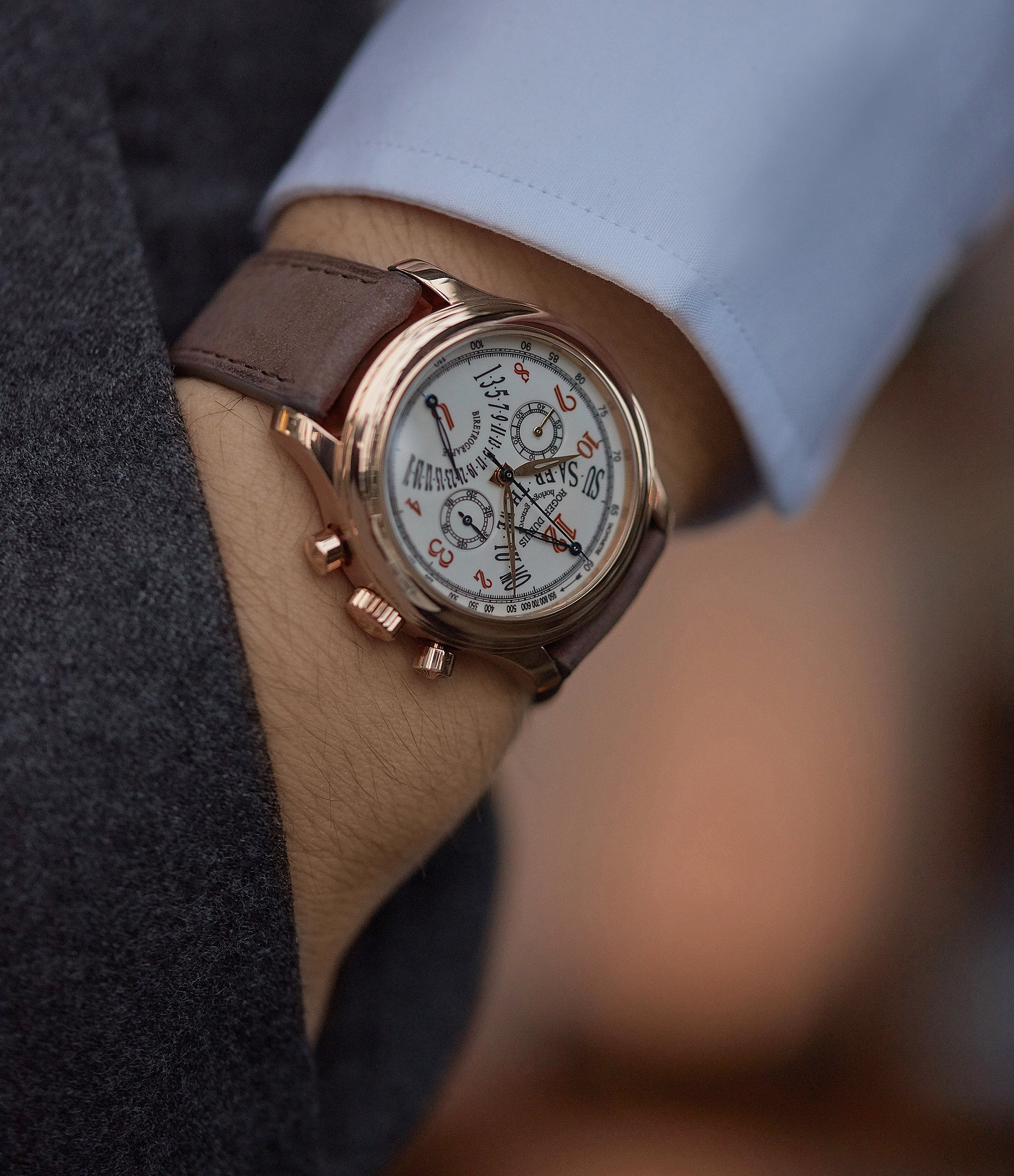 on the wrist Roger Dubuis Hommage bi-retrograde Chronograph H40 560 limited edition rare rose gold lacquer dial watch for sale online at A Collected Man London UK specialist of rare watches