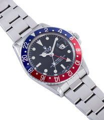 buy Rolex GMT Master 1675 vintage steel traveller sport watch Pepsi bezel for sale online at A Collected Man London vintage watch specialist