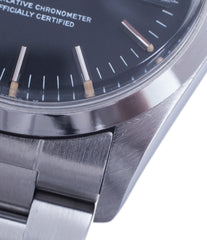white gold index markers sigma dial Rolex 1500 steel black date sports vintage watch for sale online at A Collected Man vintage watch specialist