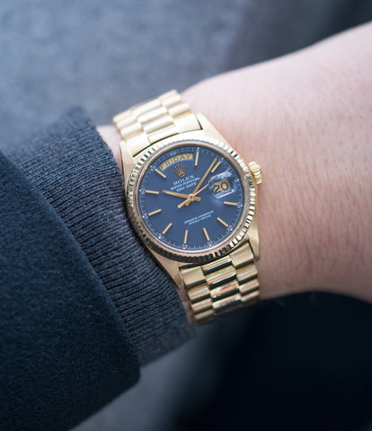 on the wrist vintage Rolex Day-Date 1803 Oyster Perpetual Cal. 1556 gold watch blue dial for sale online at A Collected Man London UK specialist of rare watches
