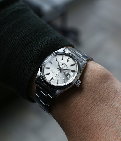on the wrist vintage Rolex 1500 Oyster Perpetual Date steel sport watch online for sale at A Collected Man London vintage watch specialist
