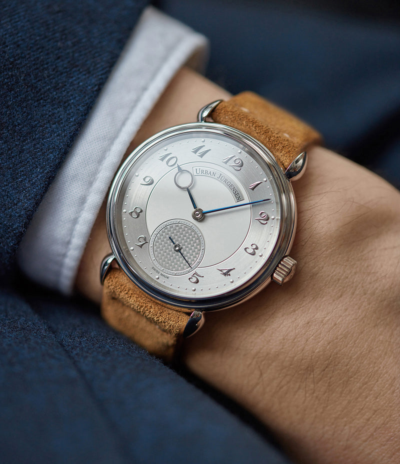 on the wrist Urban Jurgensen 1140 PT Silver dial watch online at A Collected Man London independent watchmaker specialist authorised retailer in the UK