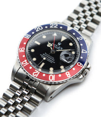 buy Rolex GMT Master with Tiffany dial 16750 stainless steel automatic Cal. 3075 vintage authentic pre-owned dress, sport luxury watch from 1984 with black dial and stainless steel Rolex bracelet with date, chronometer, gmt, hours, minutes, center seconds