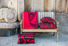 red pillow and blanket display