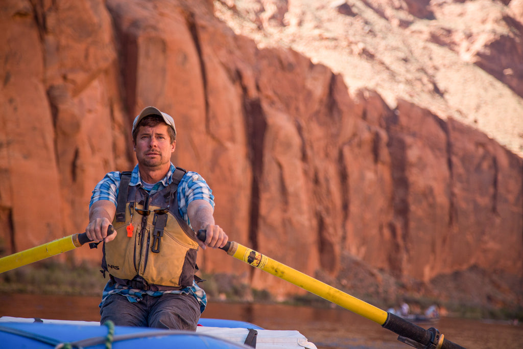 Author Kevin Fedarko rowing the Colorado River through the Grand Canyon