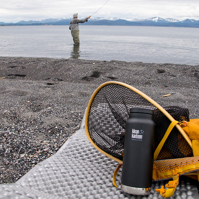 Klean Ambassador Sean Jansen fishing in Yellowstone Lake with Klean Kanteen
