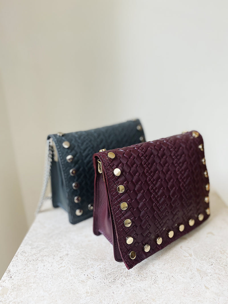 The Claret Kristi Embossed Weaved Leather Stud Bag Lifestyle