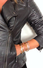 ENYO SILVER AND GOLD STACKED BRACELETS ON MODEL