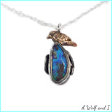 Opal locket pendant with a Golden bird