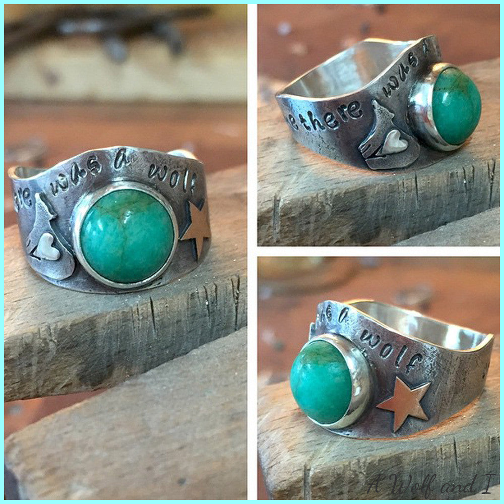 Turquoise bear ring with a gold heart and star.