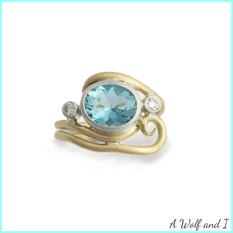 Yellow Gold 18t with an aquamarine and diamonds