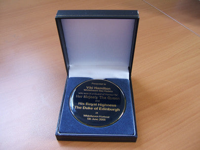 Custom designed medal in presentation box.