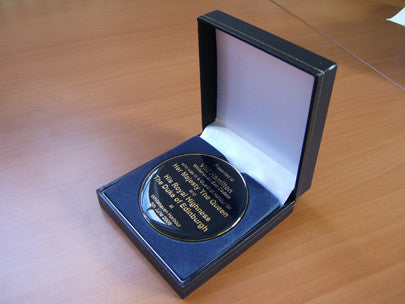 Custom designed medal with presentation box.